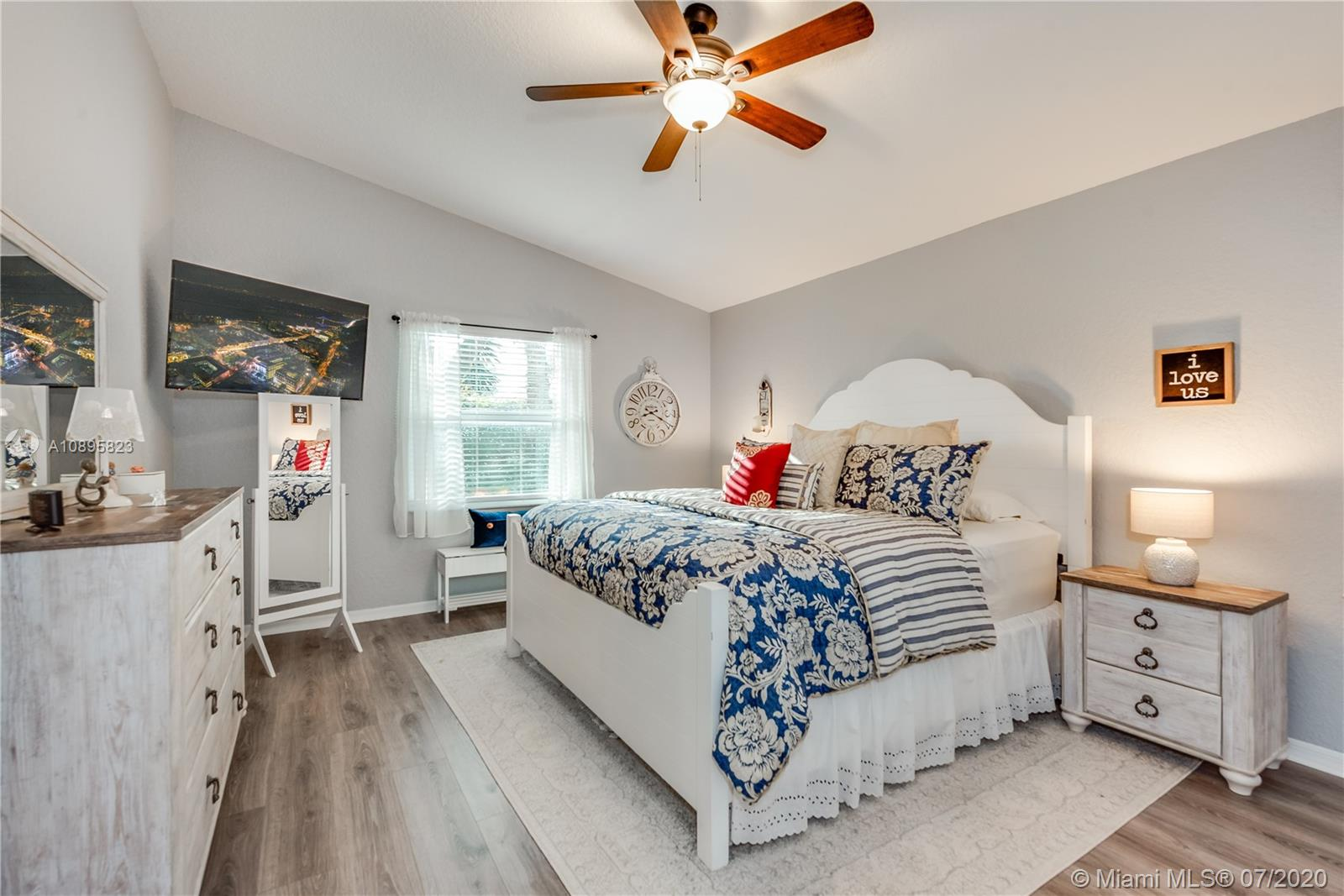Master Suite fit for a king size bed with plank flooring