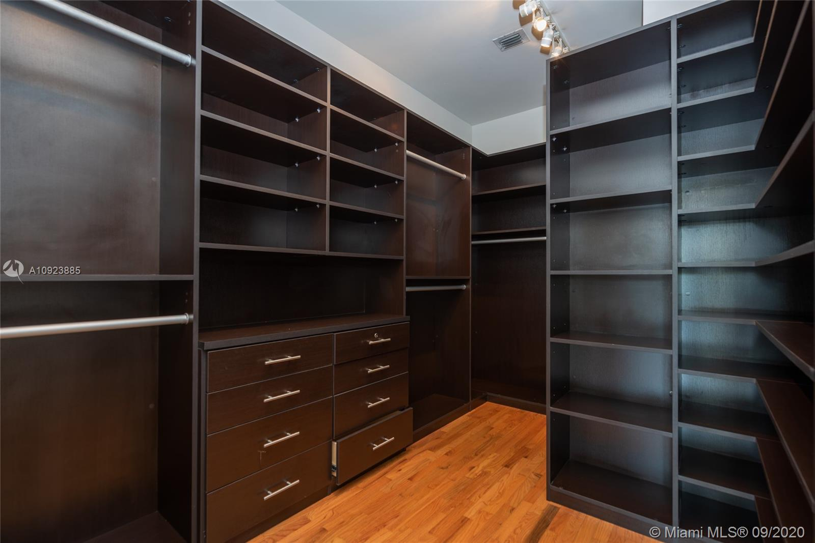 Two large walk-in built-out closets in primary bedroom