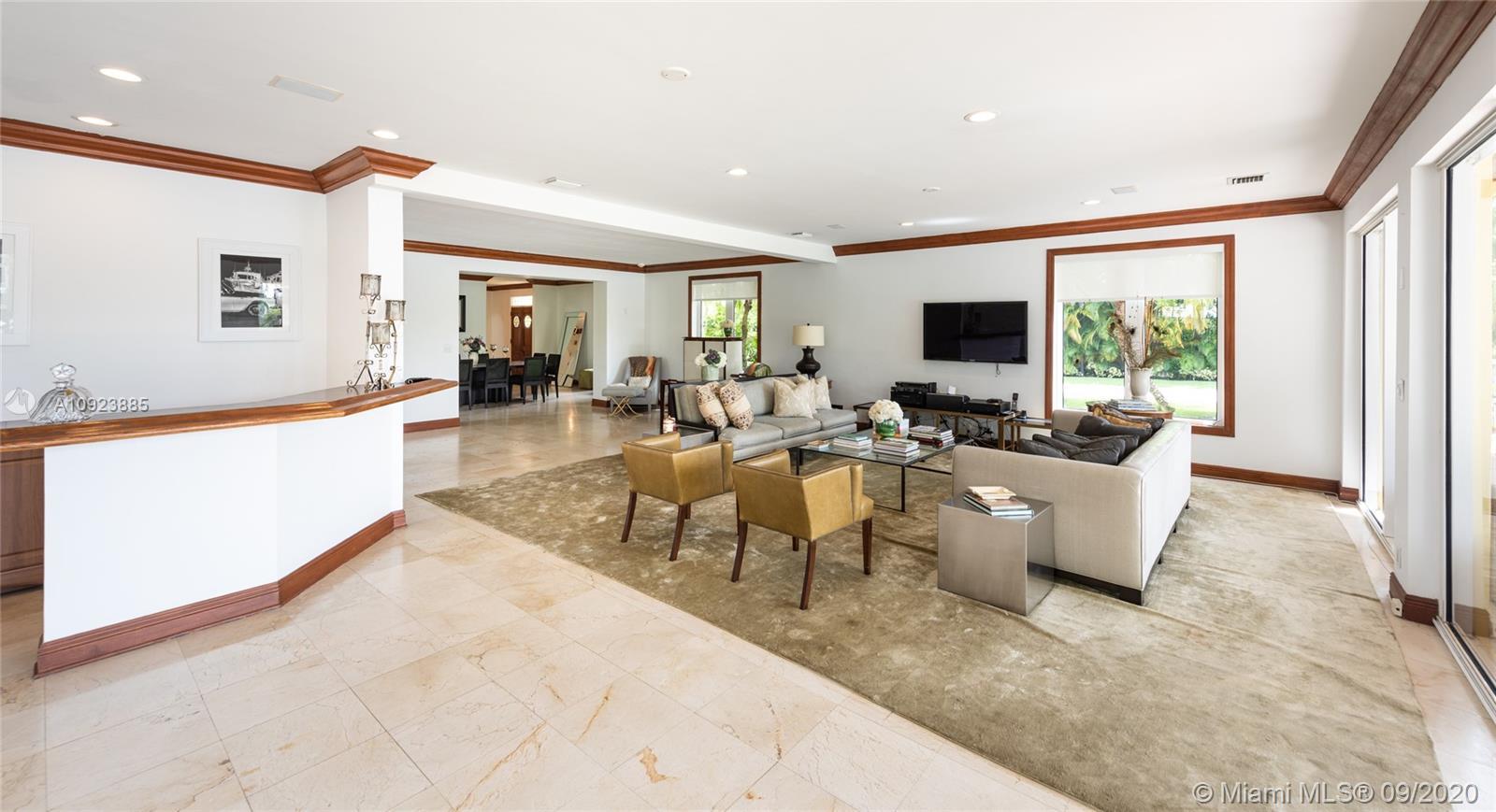 Living room with adjacent wet bar