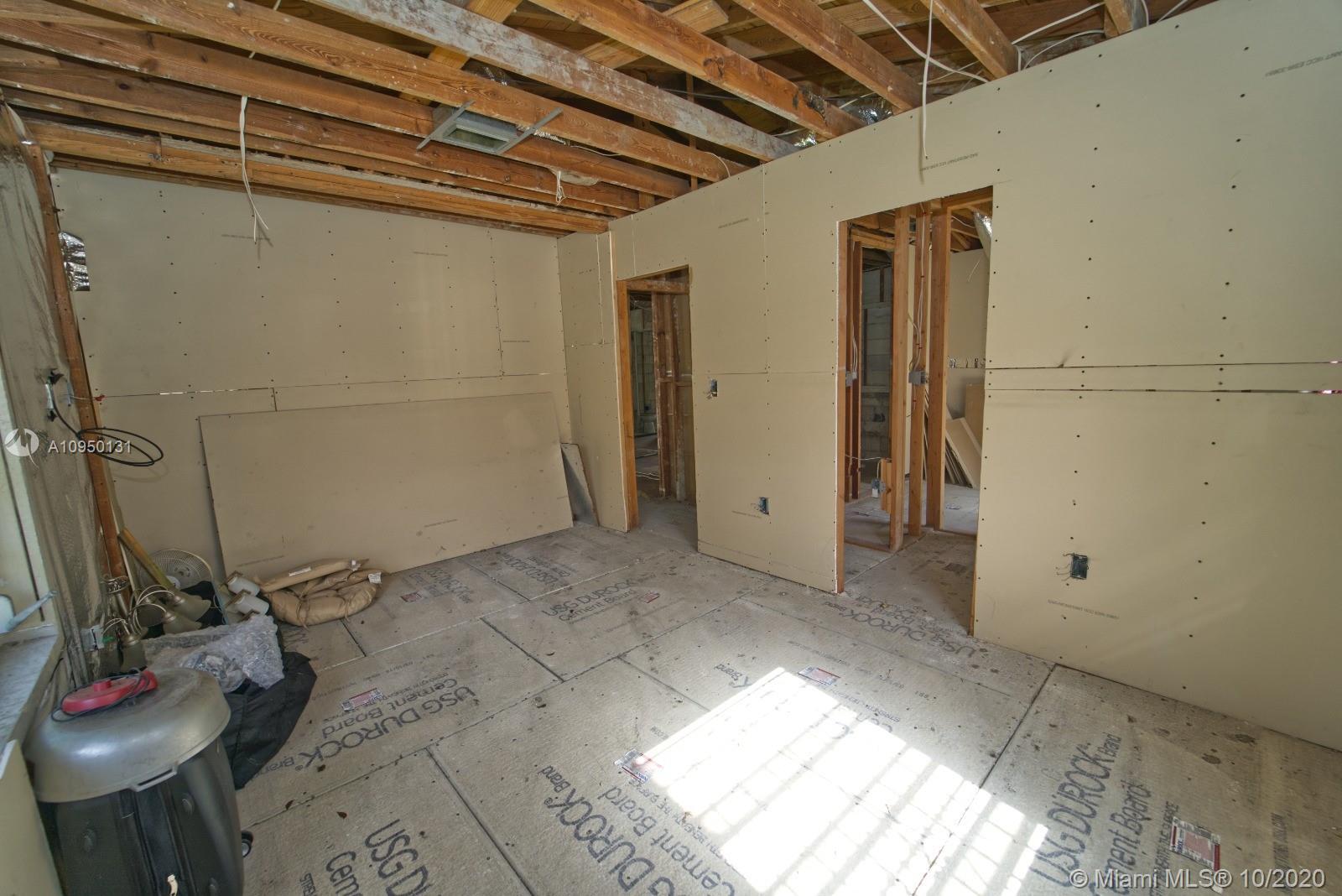 Bedroom. New sheetrock on walls. New durock on floors.