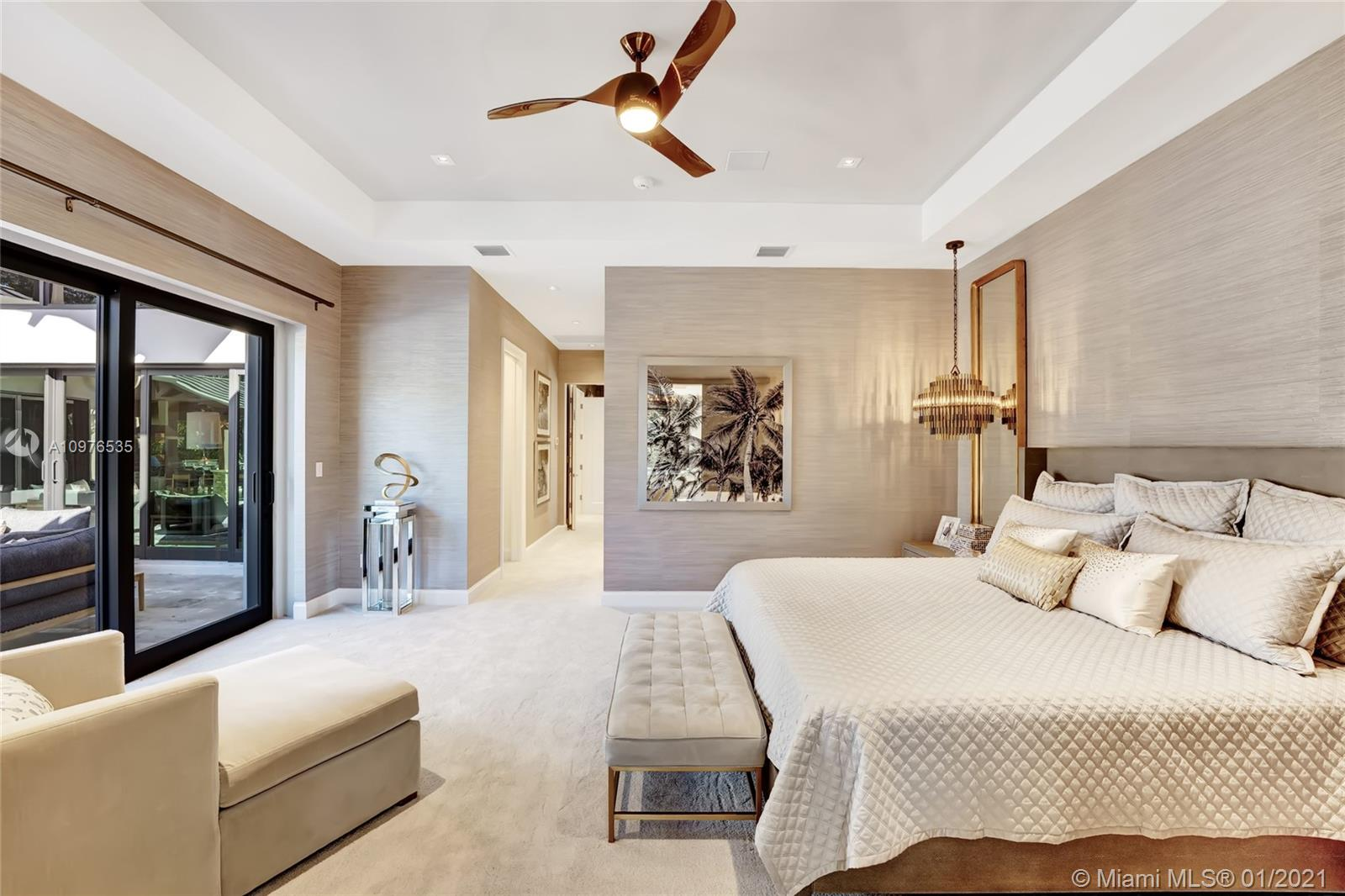 The master bedroom is adorned hand made burlap wall covering and is professionally decorated throughout.