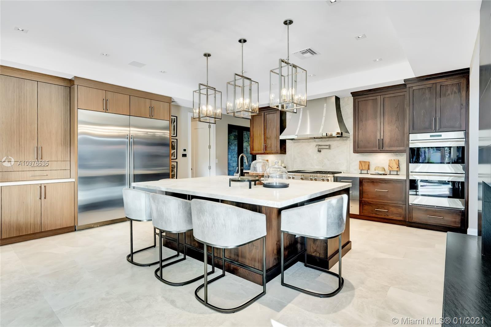 Wolf appliances, quartz counter tops, pot filler faucet, sub-zero refrigerator, all carefully designed to make this a place for the family to congregate and enjoy.