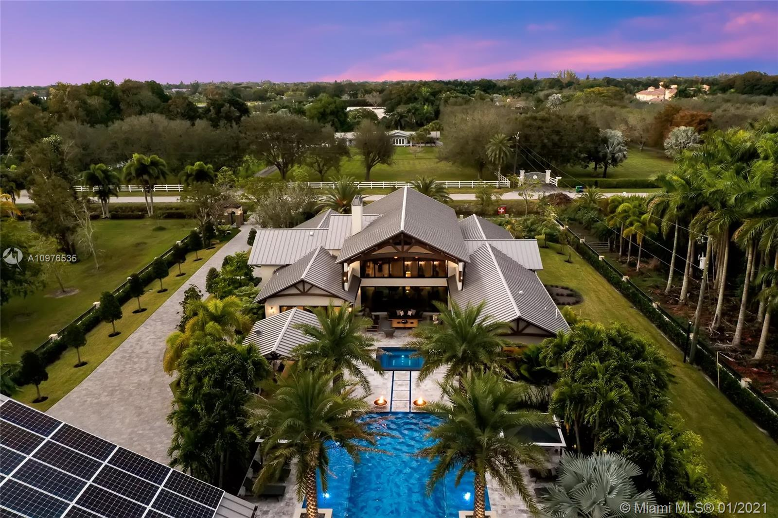 Twilight view of a portion of this masterpiece situated on 2.35 acres.