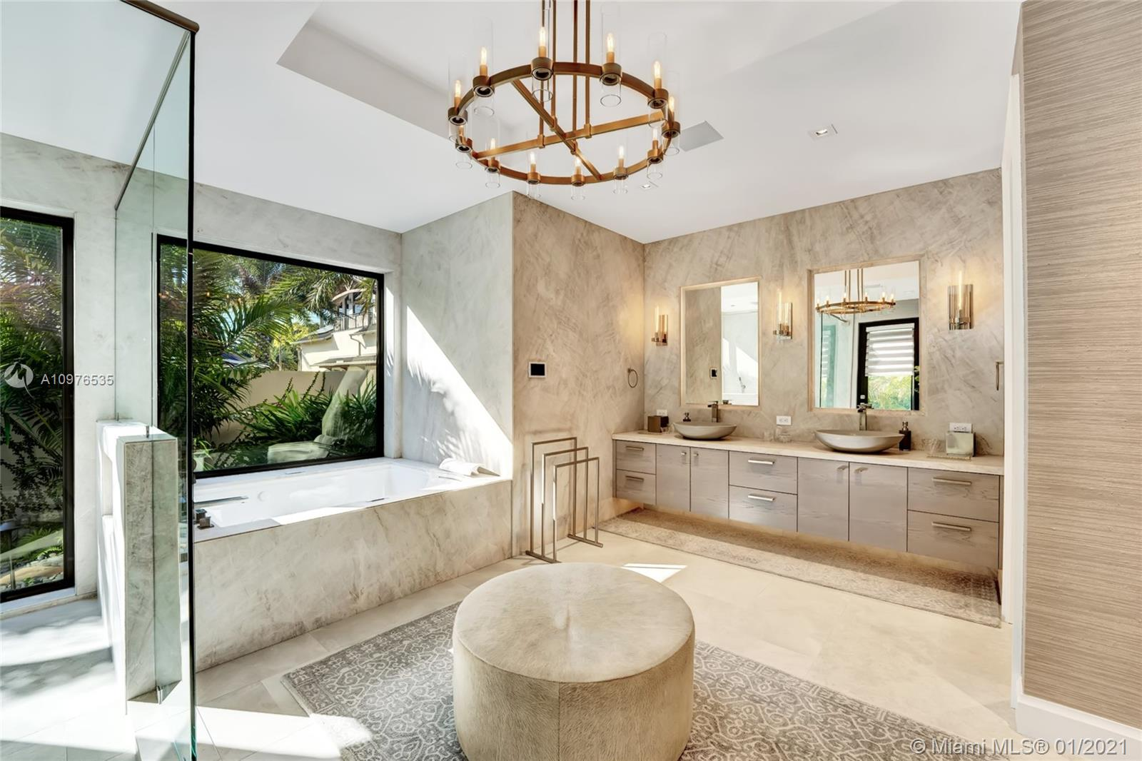 The master bath is adorned with sandstone sinks with high end materials throughout, including quartz countertops.