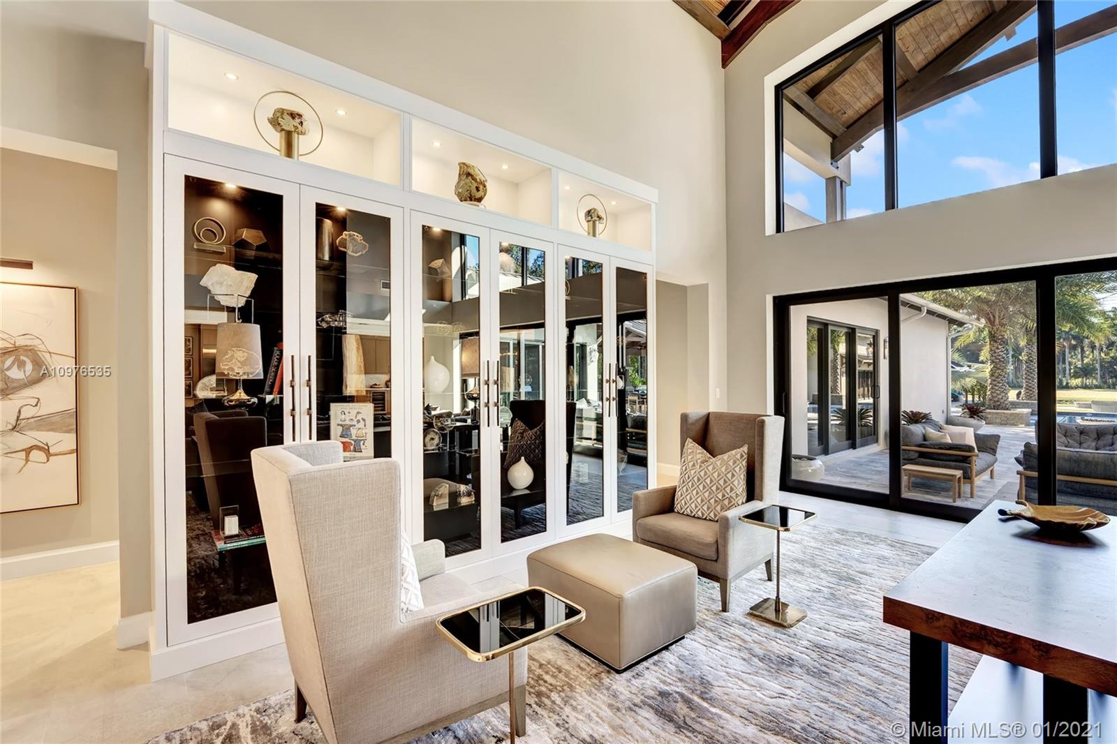 Living room, with volume ceiling, overlooks a gorgeous outdoor entertaining area.
