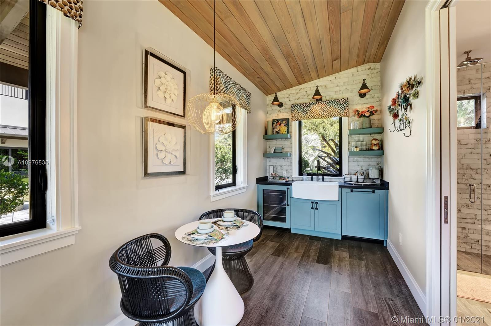 This lovely kitchen area provides additional charm in this delightful guest house! Porcelain floors.