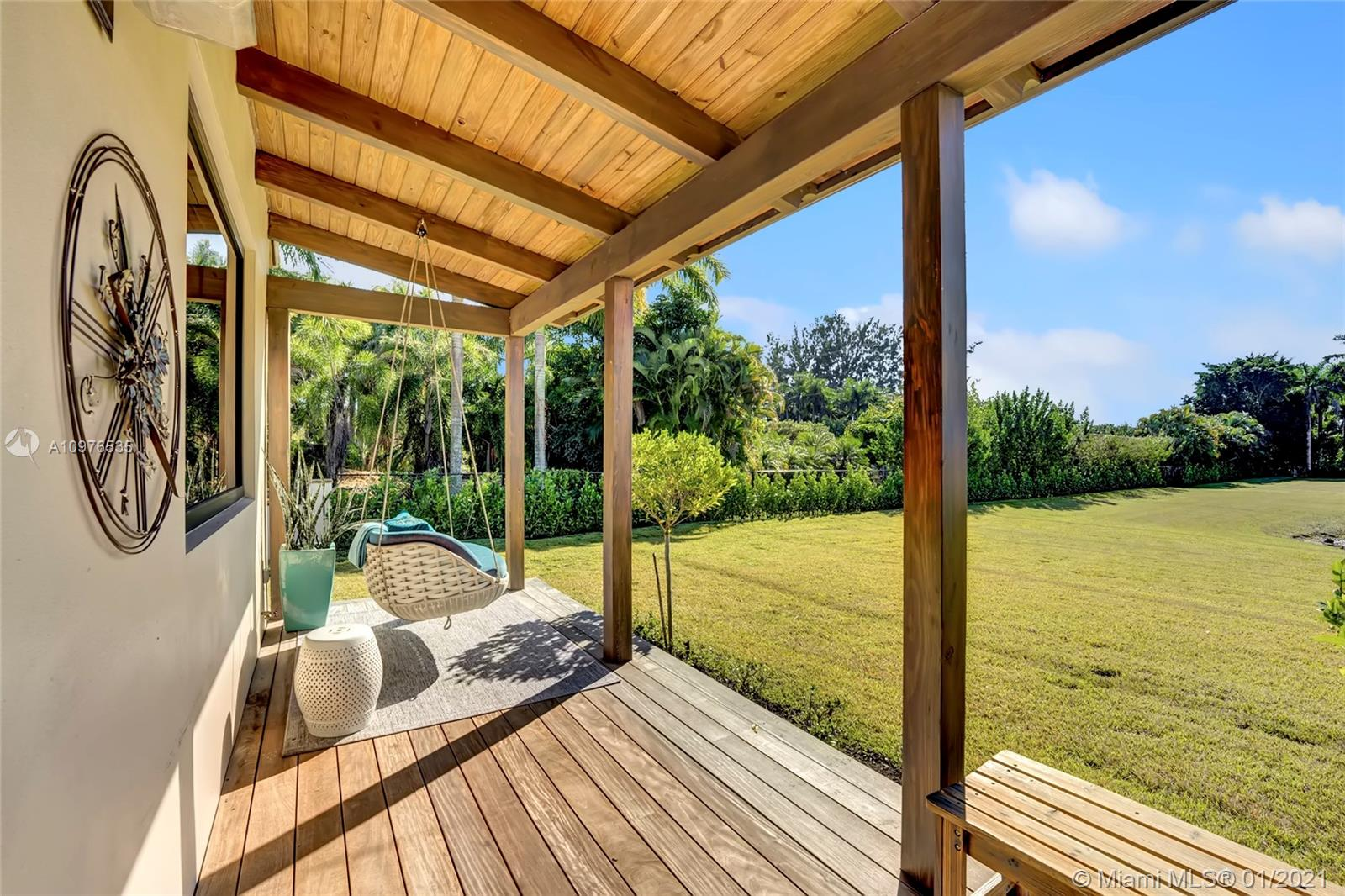 Swing from the outside porch area offers a great view to your private pond, situated on 2.35 acres.