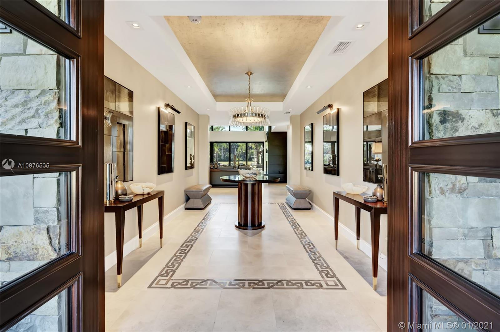 Foyer with custom wallpaper, meticulously designed by a professional.