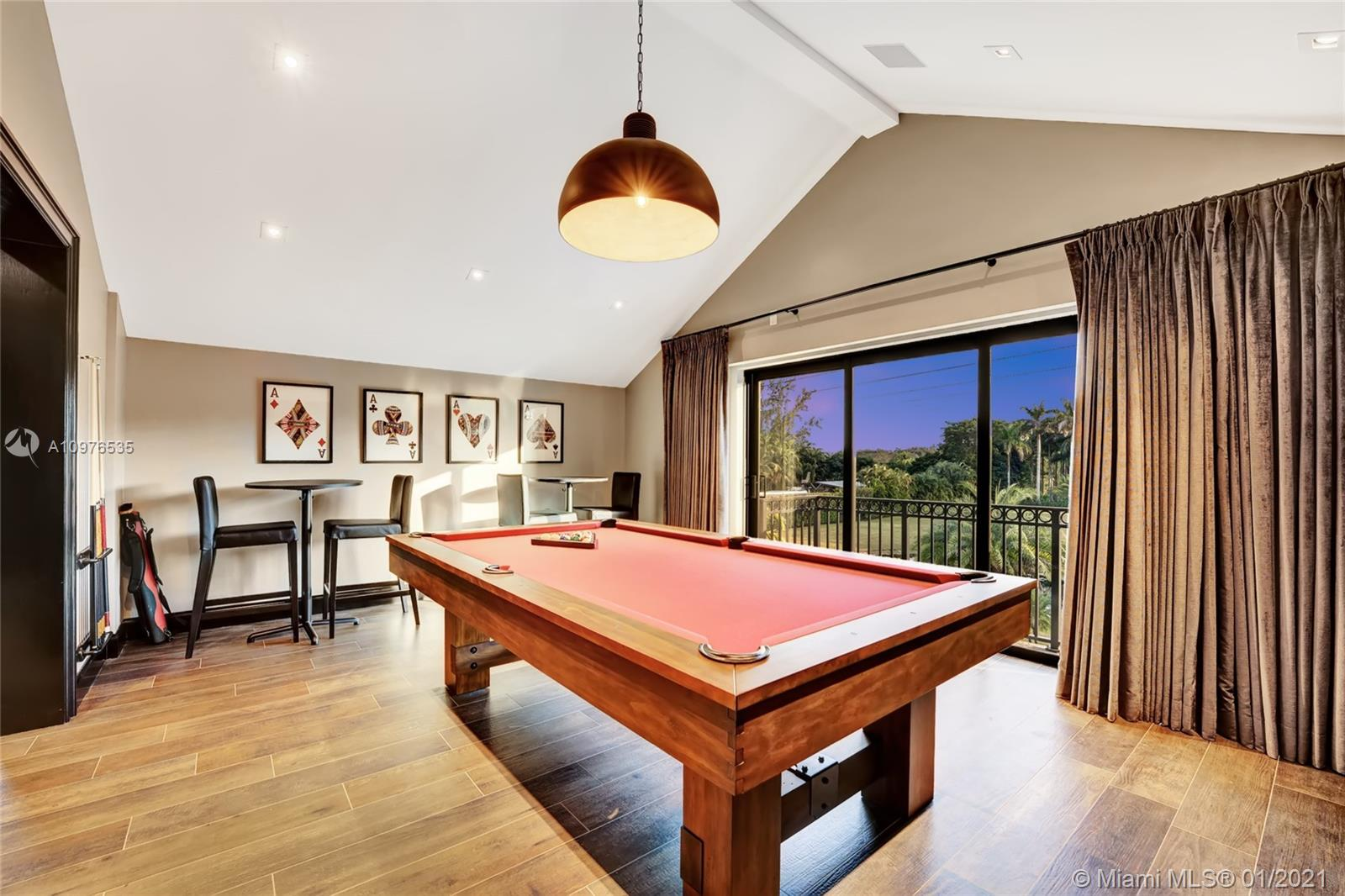 Pool table/entertainment area with sound absorption walls.