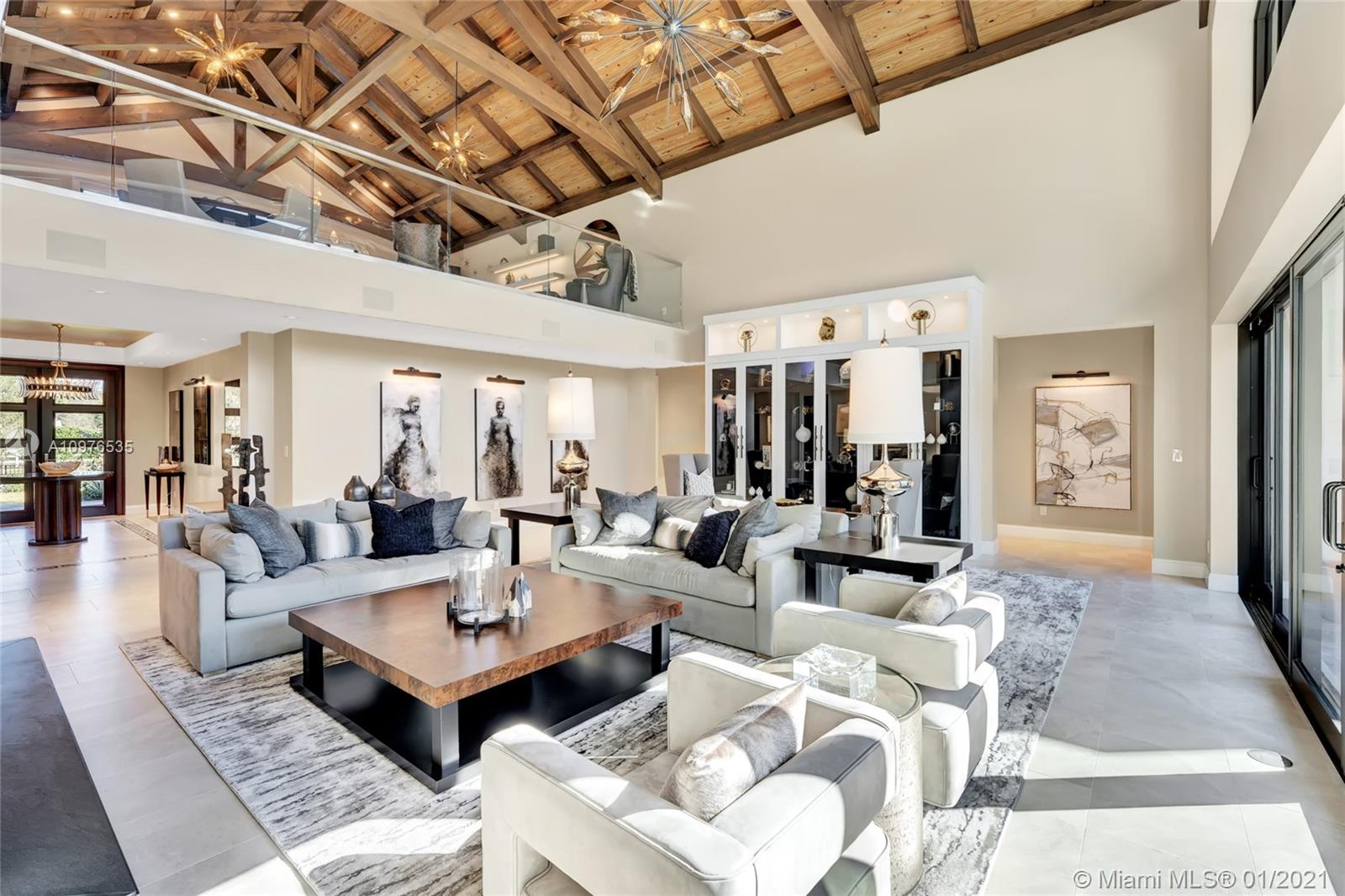 Stunning living area with horn hardware throughout it and the 1/2 bath. Custom burl wood and hand blown glass fixtures add to the luxurious feel in this space.