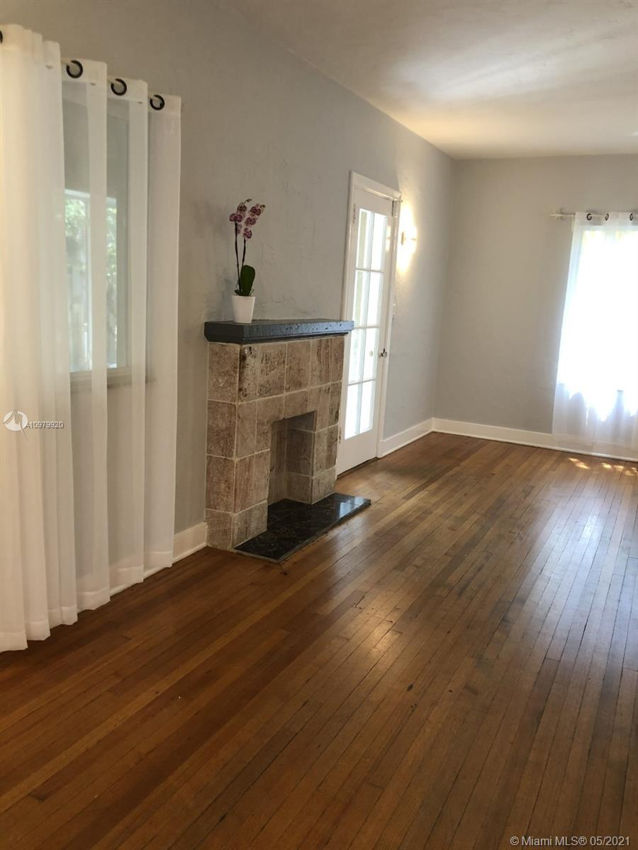 Large Living Area with Natural Wood Floors and Amazing Natural Light