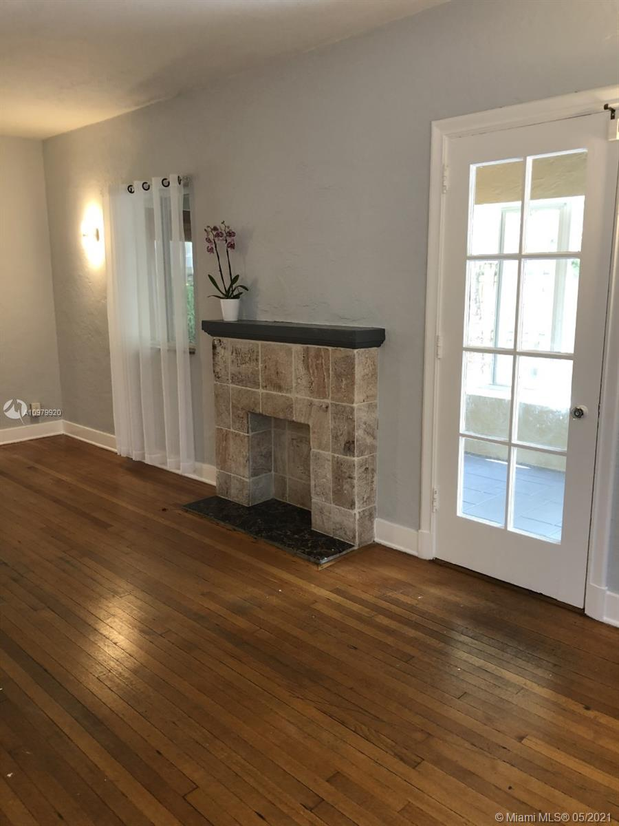 Large Dining Room with Direct Access to Kitchen and French Doors Leading to Garden/Patio
