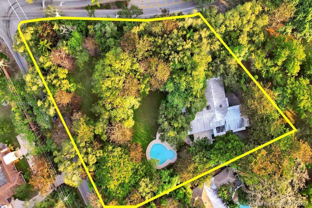 Aerial view of property with views of waterway at Gables Estates