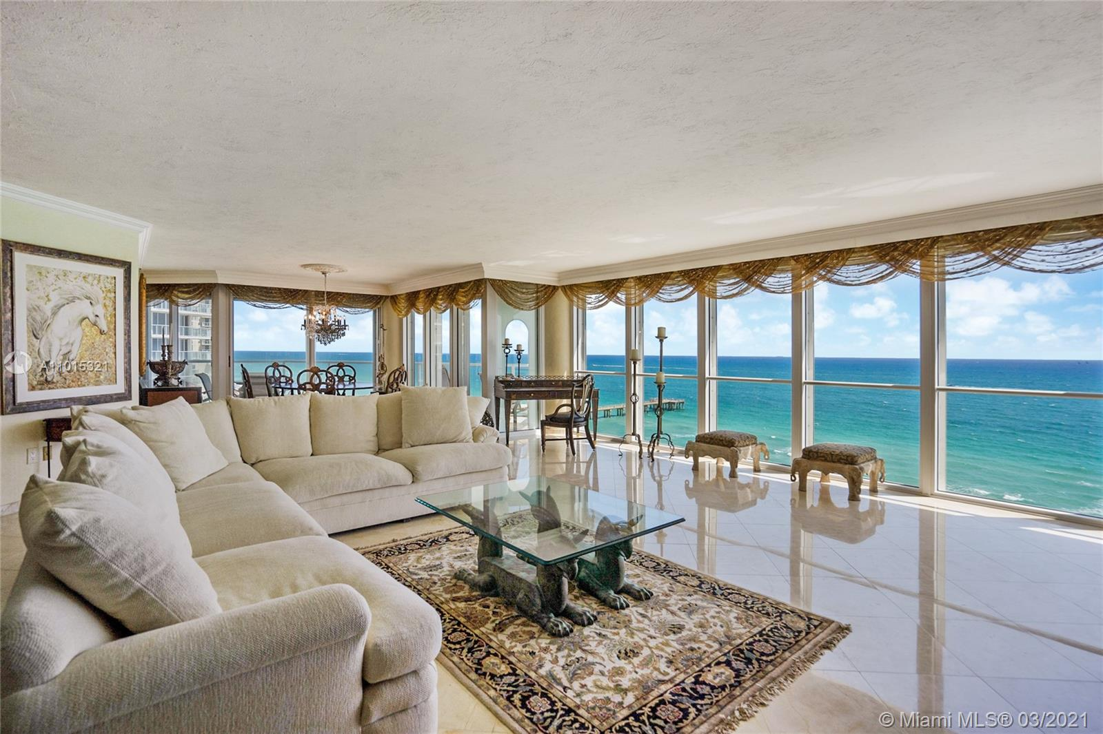 Spacious living/dining room with direct ocean views.