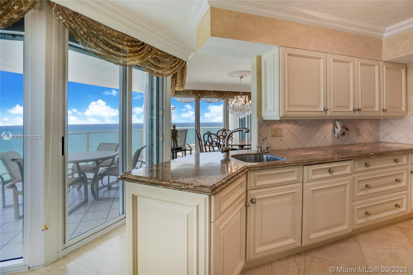 Custom cabinets and beautiful marble countertops in the kitchen.
