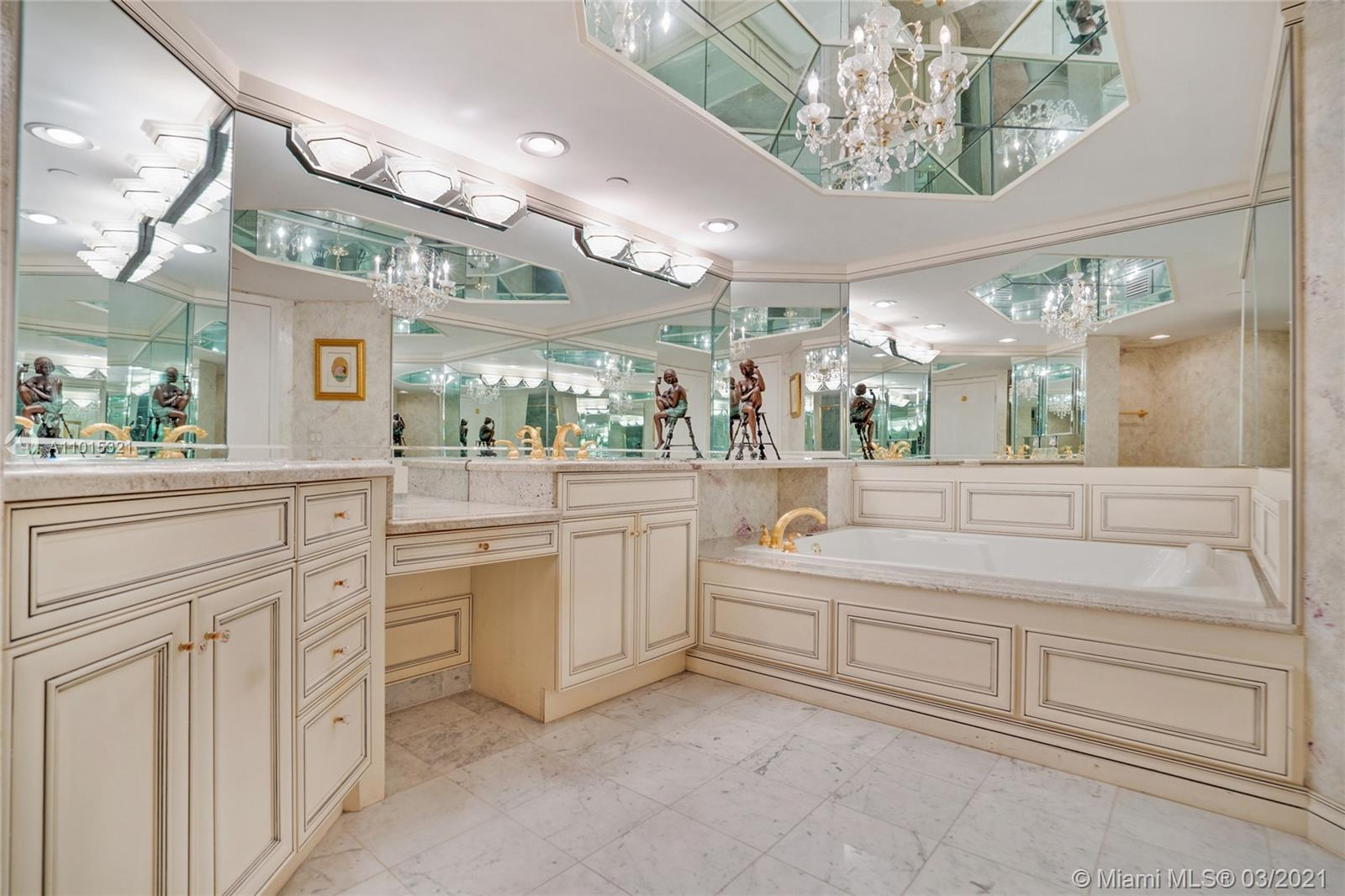 Master bathroom with double vanity, jacuzzi bath and separate shower.