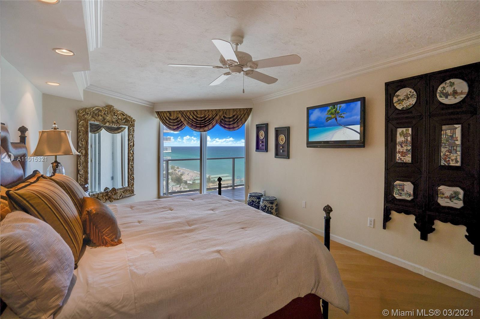Pine wood floors in the master bedroom and an oceanview.