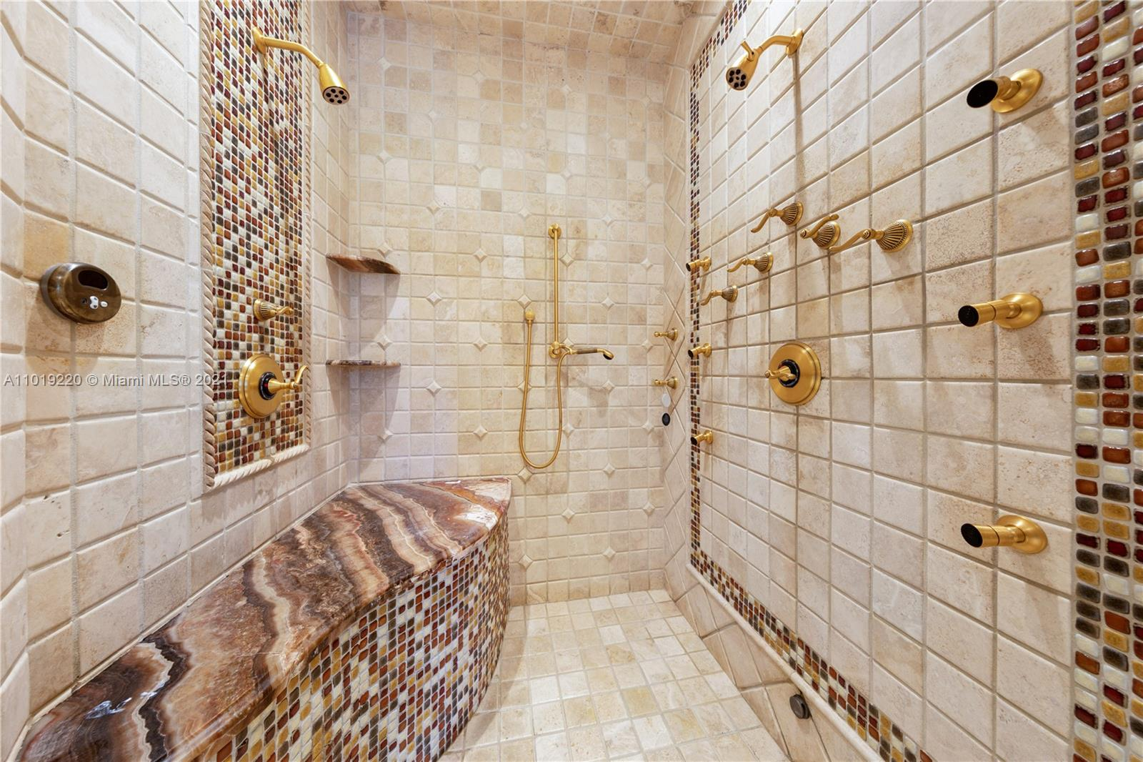 MASTER SHOWER HAS 2  SHOWER HEADS PLUS A RAIN HEAD, THE SHOWER HAS 6 JET SPRAYS , A HAND HELD AND A STEAM SHOWER.