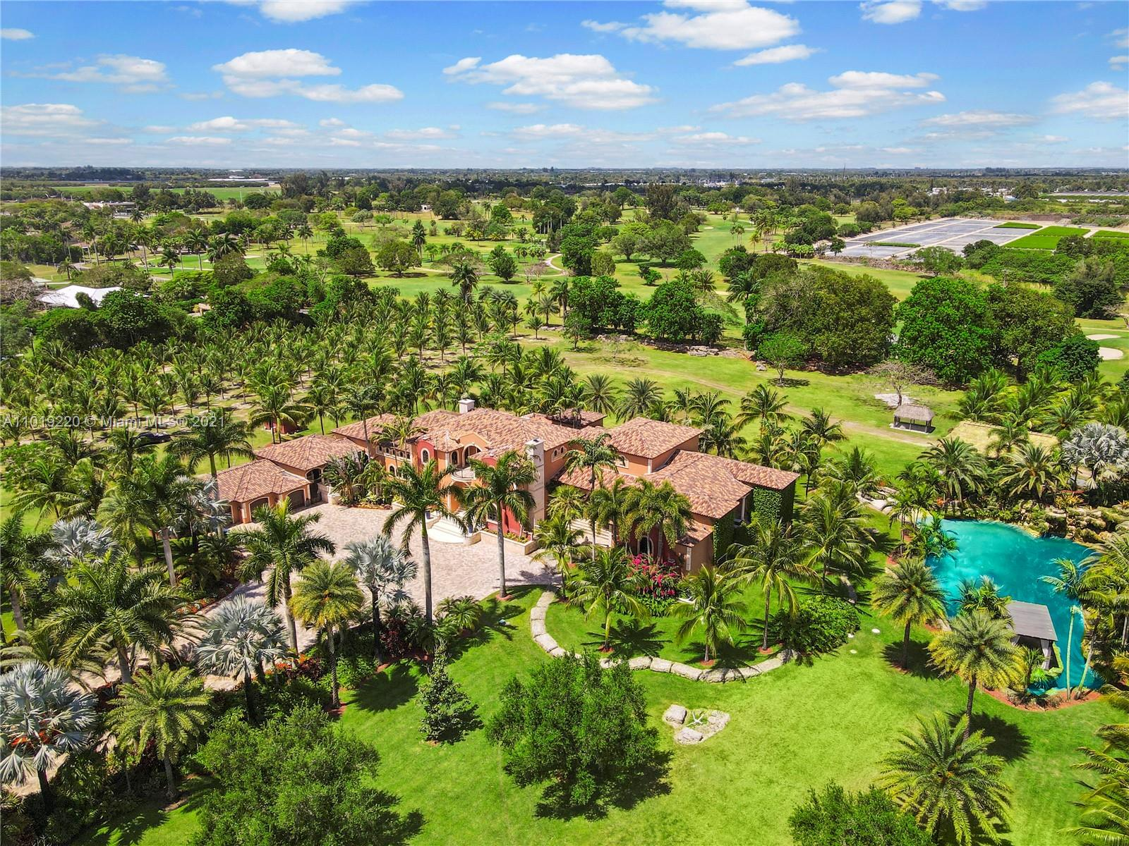 10 ACRE SPRAWLING ESTATE HOME IN REDLAND WITH SPRING FED SWIMMABLE GROTTO W FALLS.