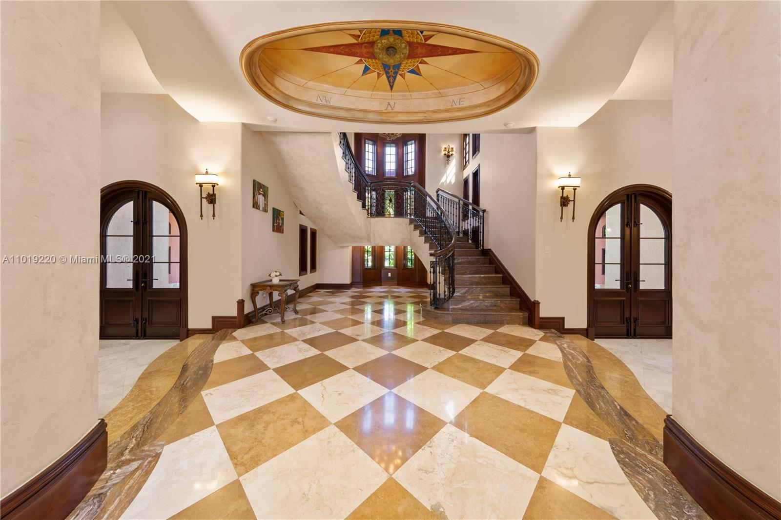 COMPASS FOYER: HAND PAINTED COMPASS THAT INCLUDES GOLD LEAF IN DESIGN AND HAS THE ESTATES COORDINATES. LASER CUT MARBLE STEPS AND STAIRWAYS
