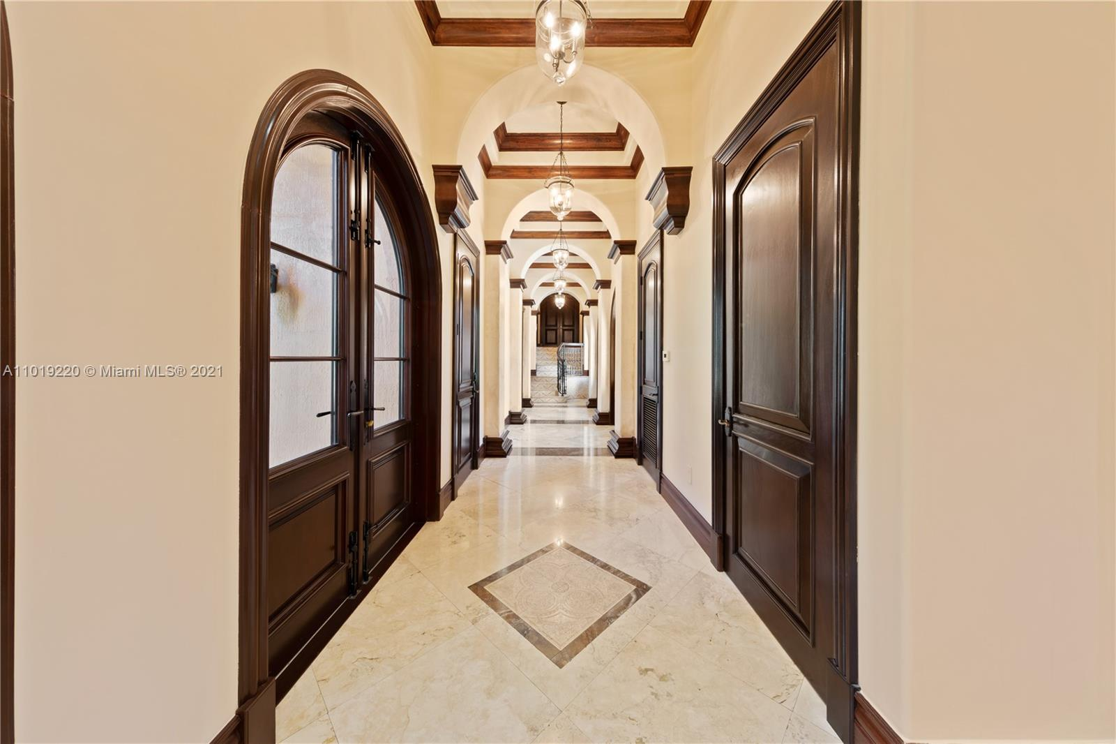 THE HALLWAY IS IMPRESSIVE AND SPEAKS FOR ITSELF.  DOORS/ WINDOWS WERE CUSTOM MADE AND IMPORTED DIRECTLY FROM HONDURAS.. HONDURAN MAHAOGANY.. THE FLOORS WERE IMPORTED BY FAMILY FROM JERUUSALEM ARE J.TRAVERTINE.