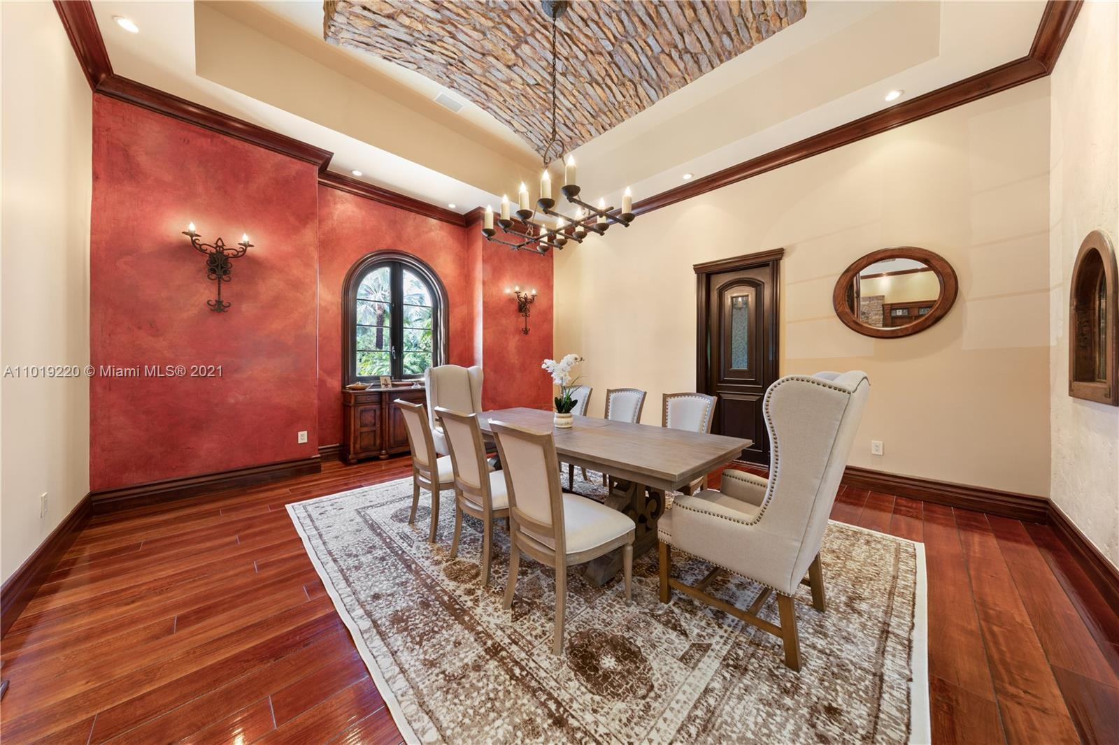 FORMAL DINING WITH CUSTOM IRON OPENS TO BUTLERS PANTRY THEN TO MAIN KITCHEN