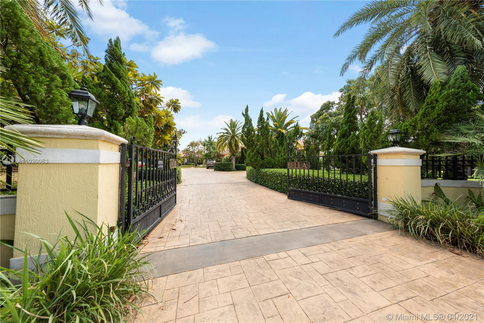 FROM THE EXTERIOR WALL AND CUSTOM GATES TO THE STATELY DRIVE IN SETS THE TONE FOR THIS ESTATE...