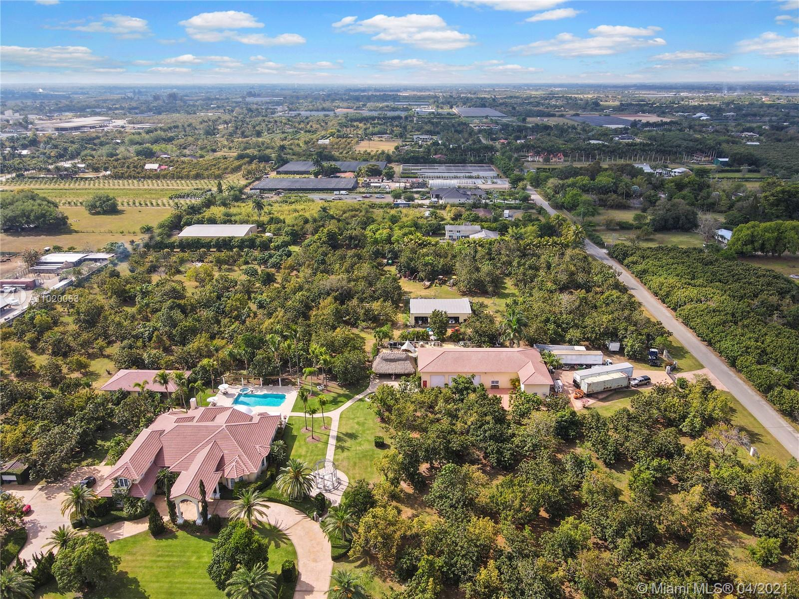 WHAT A SET UP. MAIN UP FRONT, THE GUEST IS OFF THE OVERSIZED POOL W PERGOLA AND SPA ON A LARGE PATIO ,TIKI IS NEXT TO CUSTOM GARAGE/WORKSHOP15+ CARS W OFFICE, EQUIPMENT SHED IN REAR . MULTIPLE ENTRANCES  WITH WALKWAYS  SITTING AREAS/LAWN ART THRU OUT...SURROUNDED BY INCOME GROVE