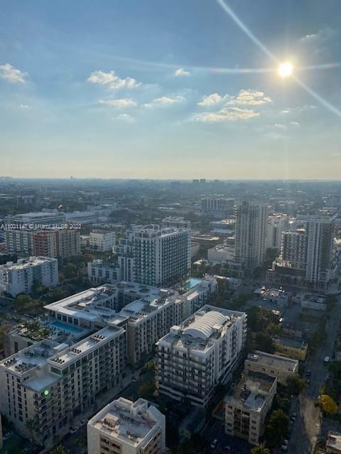 views from west terrace- can see city of coral gables and MIA control tower at a distant