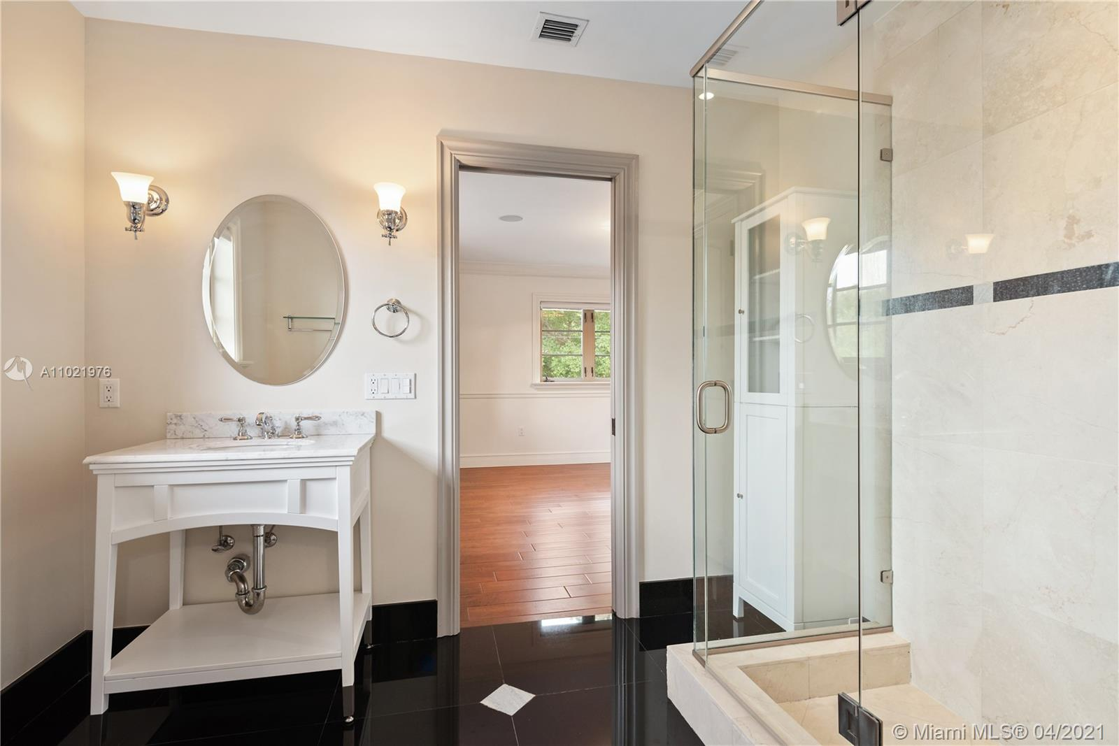 Jack and Jill Bathroom adjoining two bedrooms.