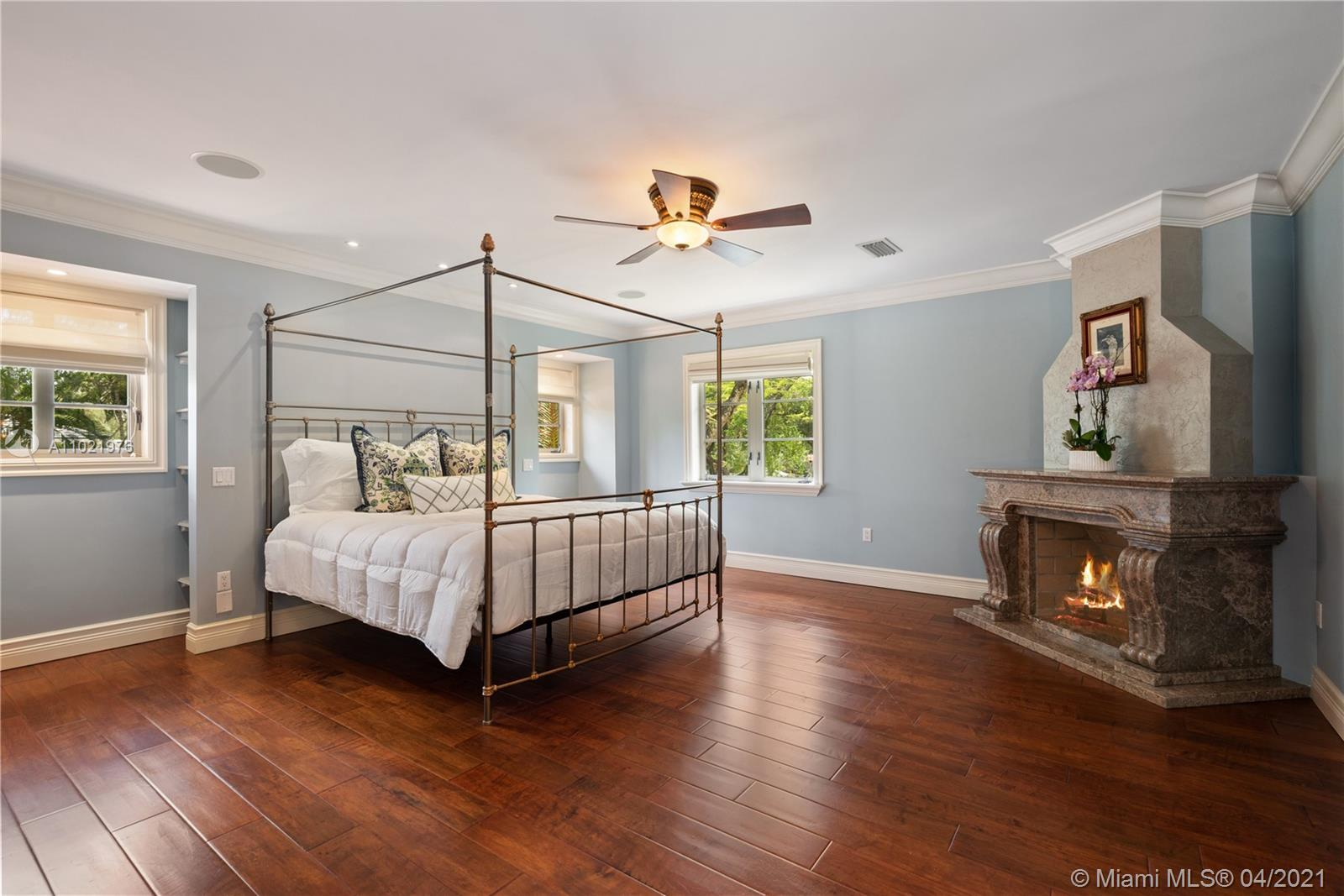 Master Bedroom has Walk In Closet with custom cabinetry.