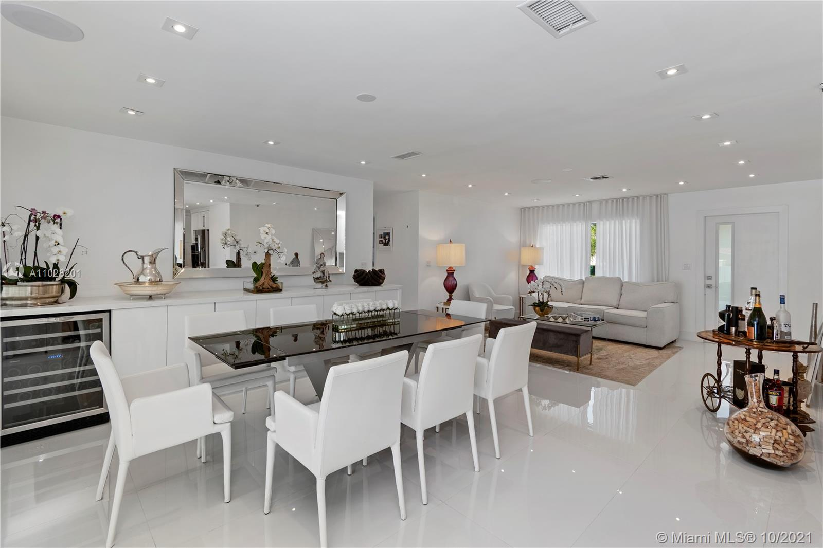 Spacious dining area with extra wine cooler and built in with quarts countertop