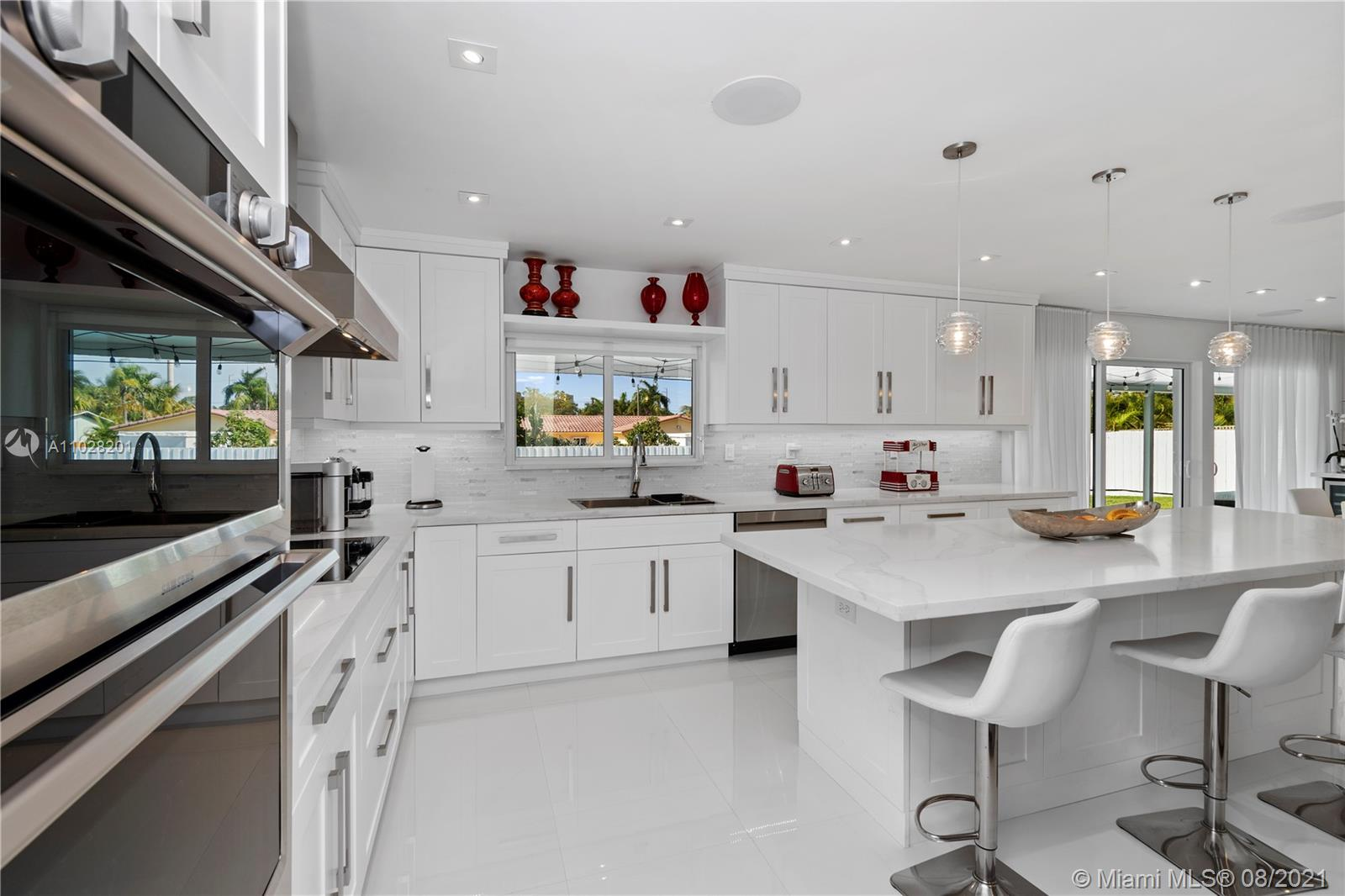 Gorgeous kitchen with all new built in oven and microwave, smart refrigerator, plenty of seating space and cabinet storage!
