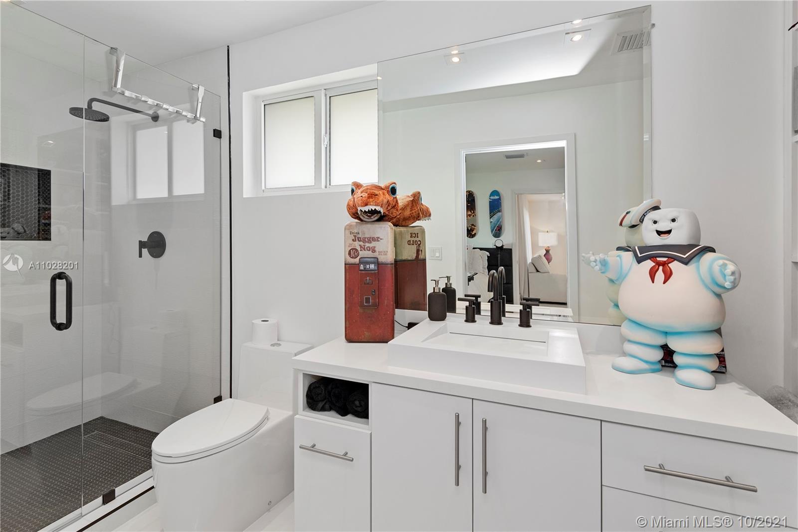 All new third bathroom with frameless glass shower door