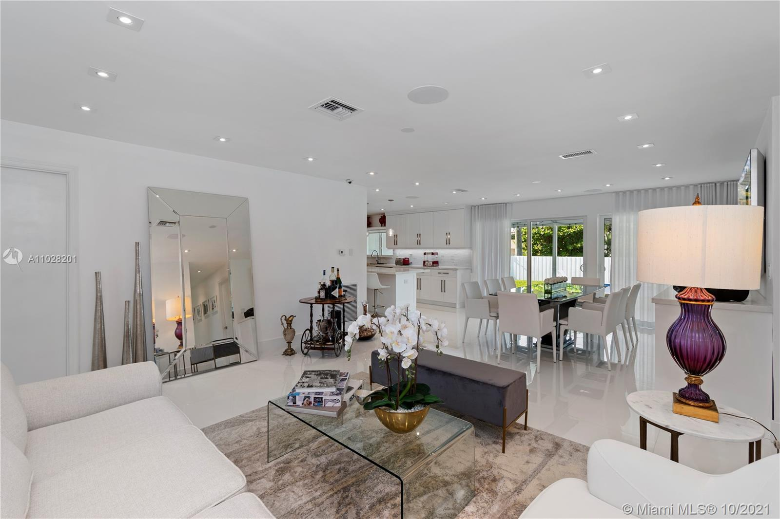 Open floor plan with lots of natural light, all flushed LED lighting and sound system throughout the entire house