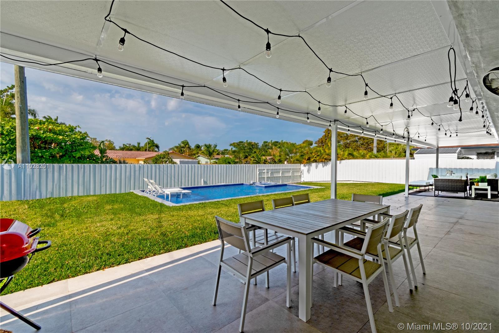 Huge backyard with covered a large area for dining, lounge and entertain. All new fencing!