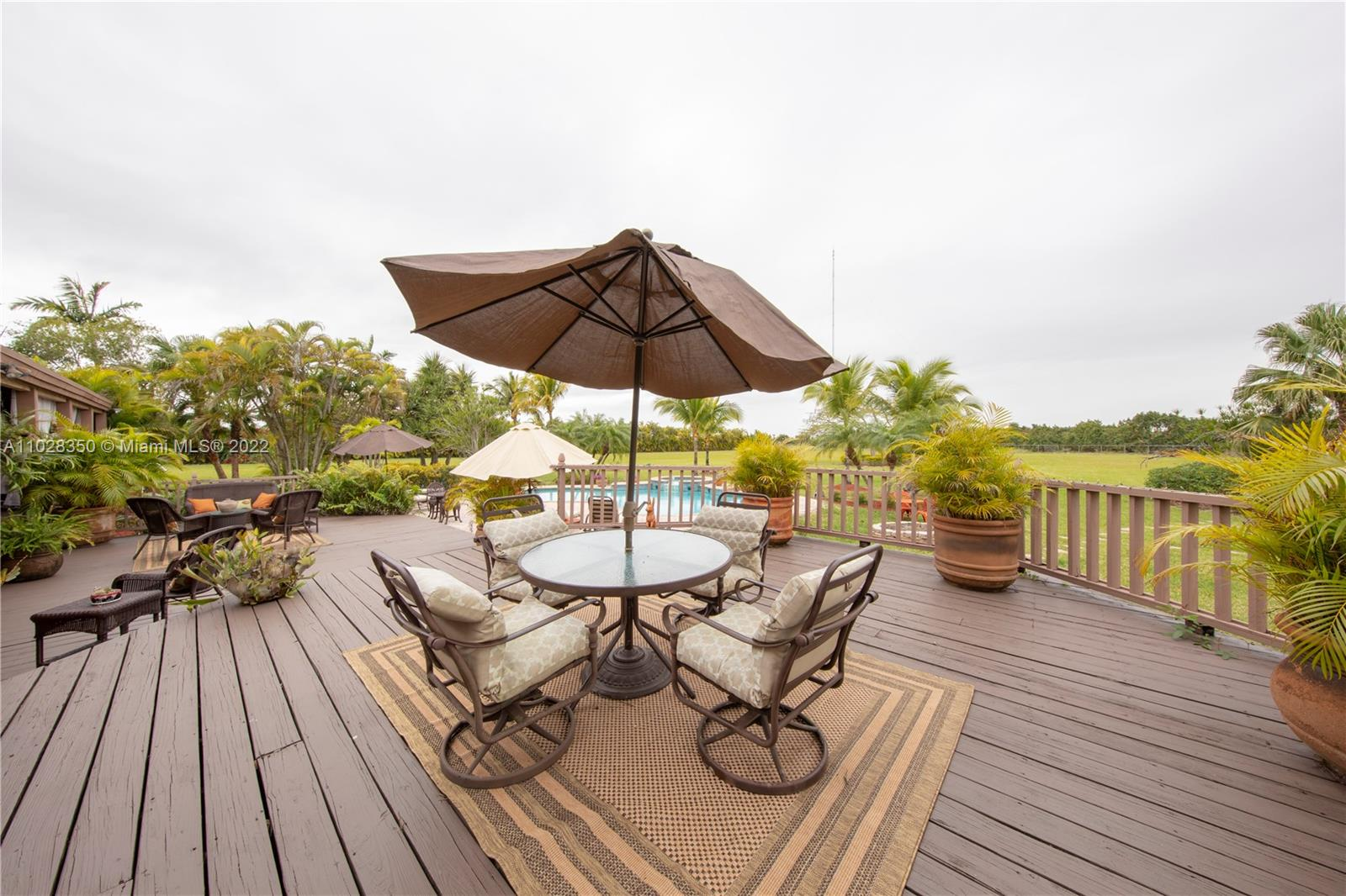 FAMILY ROOM  WITH STONE FIREPLACE( WOOD BURNING)