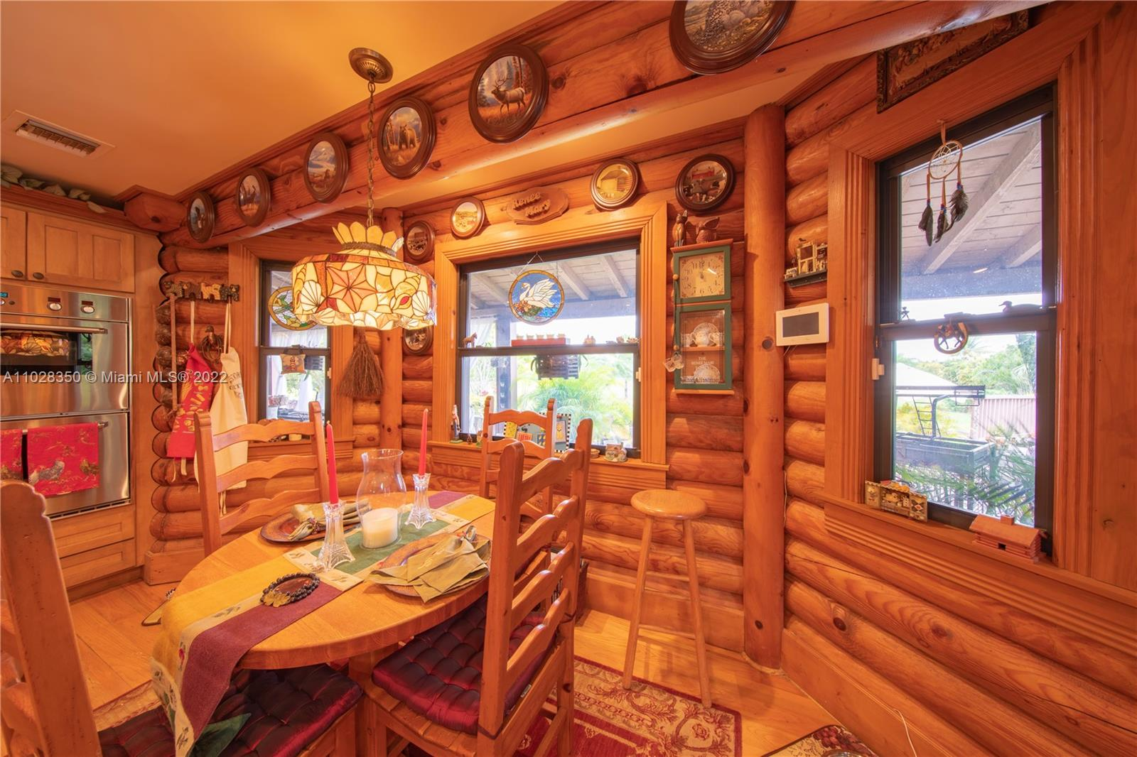 OVER VIEW OF POOL PATIO. ABOUT 3 ACRES IS CLEARLED AND READY FOR A 2ND HOME/BARN OR PLANT AS DESIRED GREAT SPACE WITH POND IN FRONT....