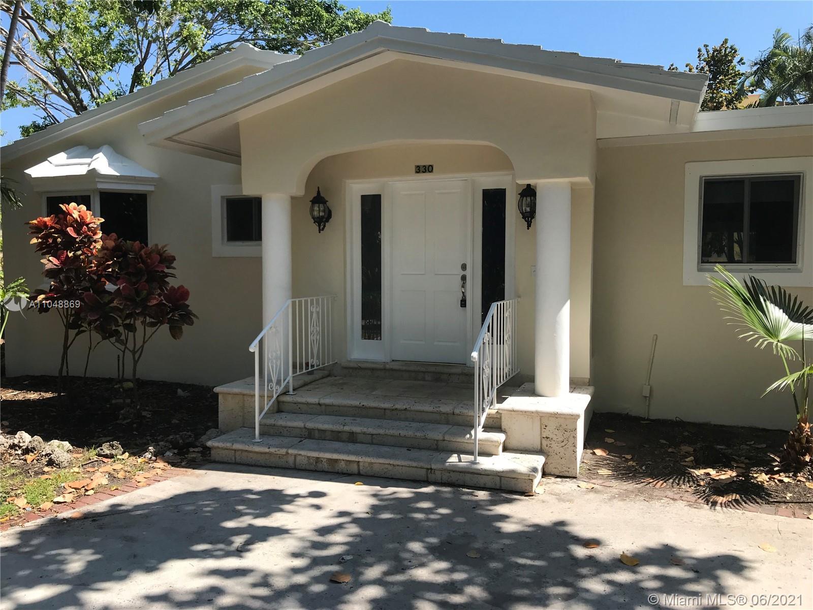 Tropical Isle Homes - 330 Redwood Ln, Key Biscayne, FL 33149