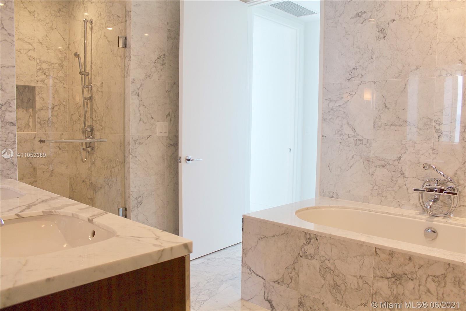 Ritz Carlton Residences #1001 - 09 - photo