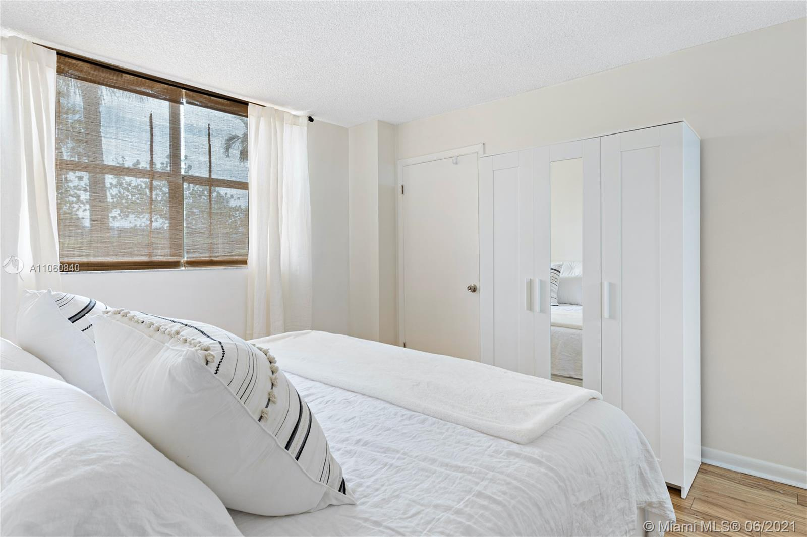 Cosy Bedroom with beautiful laminate floor and large windows.  Unit 307. 290 174th Street, Sunny Isles Beach.