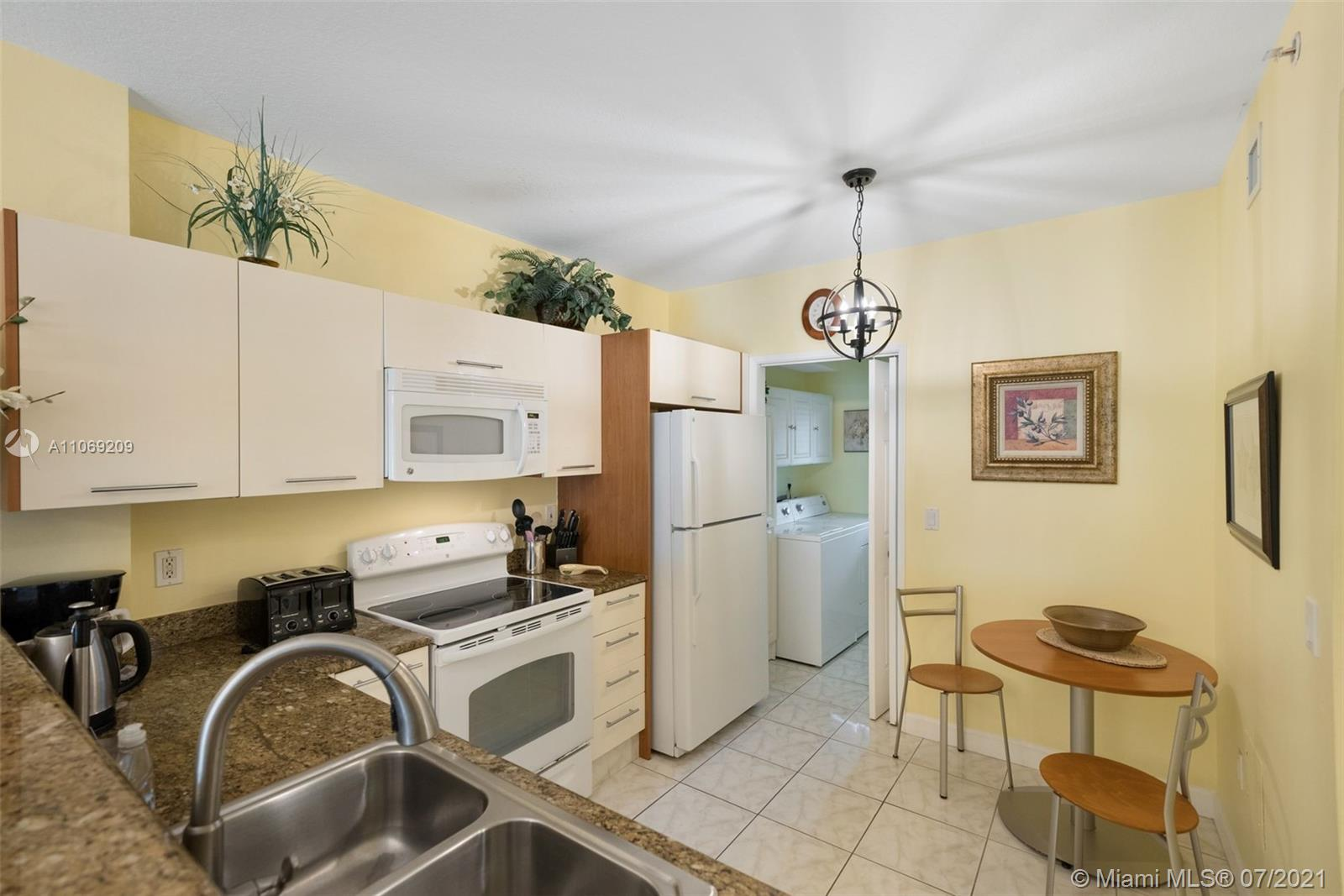 OPENED KITCHEN WITH LAUNDRY ROOM