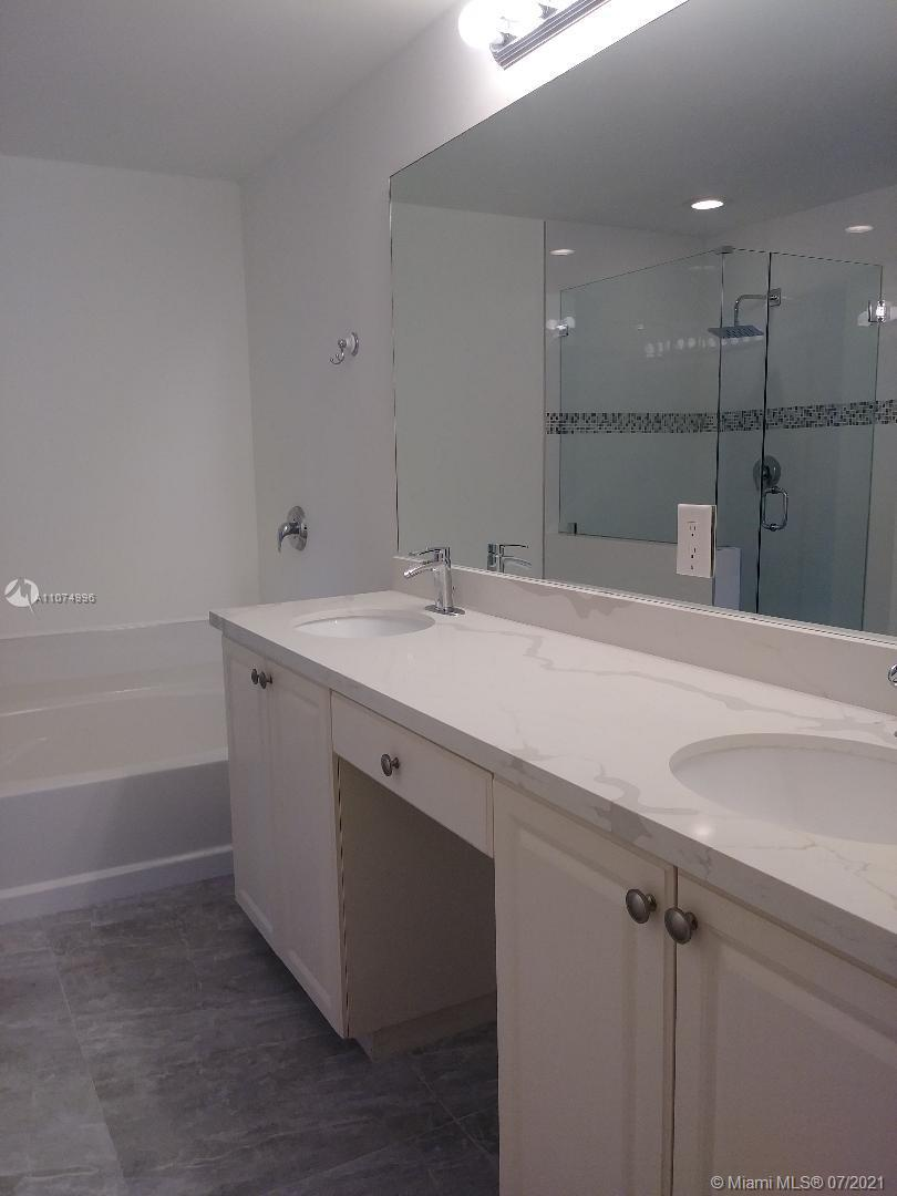 Master bath. Double sink. Combined shower and tub.