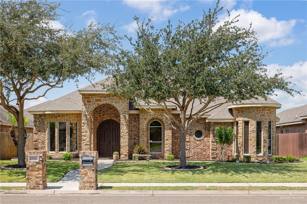 """If The """"Wish List"""" For Your Home-To-Be Includes Beautiful Curb Appeal With Professionally Trimmed Oak Trees, A Freshly Painted Grand Front Door Welcoming You Into A Marvelous Open Concept Home…This Is The Perfect Gem For You!! This Inviting Home Was Built By Reflection Homes With Bay Windows, Decorative High Ceilings, Porcelain Tile Floors, Granite Counters In The Kitchen And All Baths, An Abundance Of Windows Providing Glorious Natural Light…And It Has Been Thoughtfully Updated With Fresh Paint, New Designer Light Fixtures In Foyer And Dining Areas,  and New Kitchen Sink Hardware!  Plus, The Back Covered Patio, Outdoor Patio Flooring And Sidewalk Were Recently Painted…Looking Amazing! All This While Being Situated Around The Corner From McAllen's Crossings Park Where There Is Entertainment For Everyone…And Minutes From UTRGV, Trenton Road Shops And North McAllen's Medical Campuses! The Virtual Tour And List Of Amenities Provide More Details. Enjoy!"""