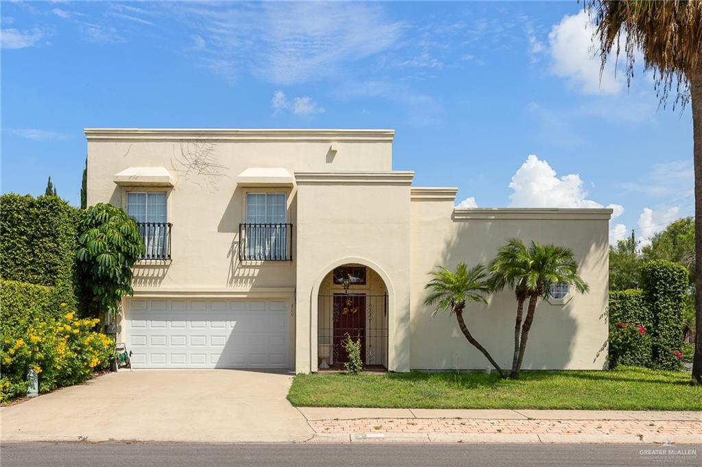 Beautiful Mediterranean townhome on corner lot. Situated in midtown McAllen on one street that turns into a cul-de-sac and is walking distance from a grocery store and many restaurants. This elegant home is living at its finest with high ceilings, large closets, a private patio, fireplace, and beautiful curb appeal.