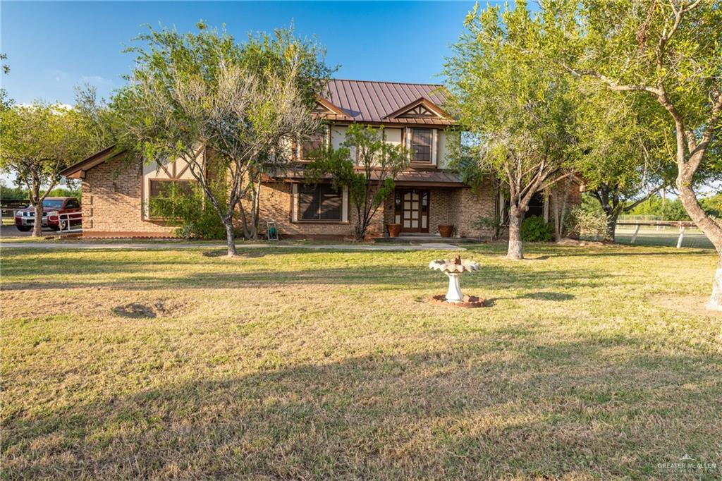 This 4 charming farm house features 4 bedrooms, 3 full bathrooms, a large family room and an office all spanning over 3348 sqft. The home is situated on 1.69 acres -/+ and located on a corner lot. There is a 4 car carport to the side of the house and a larger carport on the property that was used for a trailer home. The property also features 2 storage areas and houses for farm animals.