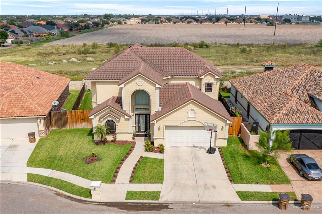Located in the gated community of West Meadows, this updated and move-in ready 2-story home is one of a kind. With close proximity to the 10th/Trenton shopping/dining zone and UTRGV this home won't last long. 4 bedrooms, 3.5 bathrooms, bonus office room, and upstairs living/game room. The kitchen features a 2021 Sub-Zero refrigerator and new custom pantry. Plantation shutters were recently installed throughout the home. Both AC units were installed in 2018. The master bedroom closet was custom built in 2021. Water softener was installed in 2019. The backyard pool has a beautiful fountain and covered pergola grilling area perfect for gatherings.