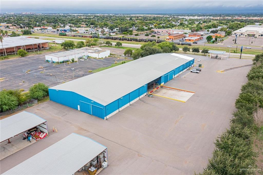 Amazing Commercial Property with enormous industrial potential, Huge exhibition room / retail space. Plenty of offices with fully equipped kitchen and break room. The warehouse is equipped with 2 loading docks, eight garage spaces with mezzanine above, two  double height metal industrial canopies with Concrete Slab, in a fully paved area.  Feel free to contact the listing agent for mac specifications regarding the property. ***** This property has Loading railroad Spurs *****