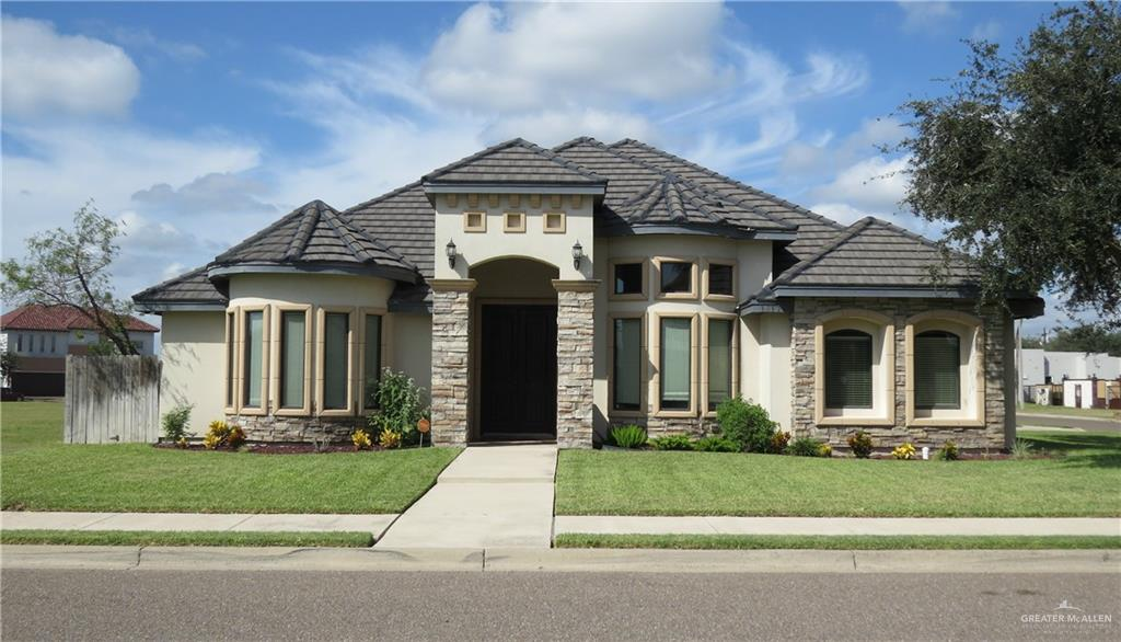Be One of the First to Tour this Beautiful 3 Bedroom Home In the Tuscany Village subdivision and Sharyland Pioneer School District!  Features One Open Living Area, Two Dining Areas, A Split Bedroom Floor Plan, Fresh Paint, Smooth Ceilings, Stainless Kitchen Appliances, Hardwood & Tile Floor, 9 Foot Doors, LED Lights Throughout and Wired for Nest/Digital Thermostat & Video Surveillance.  The Large & Bright Kitchen has Lots of Cabinets & Pantry Providing Fabulous Storage and A Breakfast Bar.  The Huge Master Bedroom has a Sitting Area, Numerous Windows Providing Natural Light, Master Bath is So Spacious and Boasts an Enormous Walk-In Shower w/ Dual Shower Heads, Good-Sized Closet, Double Vanities & Sinks Give each Partner His/Her Own Space. Enjoy the Backyard/Patio with a Sparkling Pool & Water Feature, a Privacy Fence and Side-Entry Garage.   The Concrete Tile Roof, Stone Accents and a Corner Lot give this Home Tremendous Curb Appeal!  Make An Appointment Today......Before I'm GONE!!