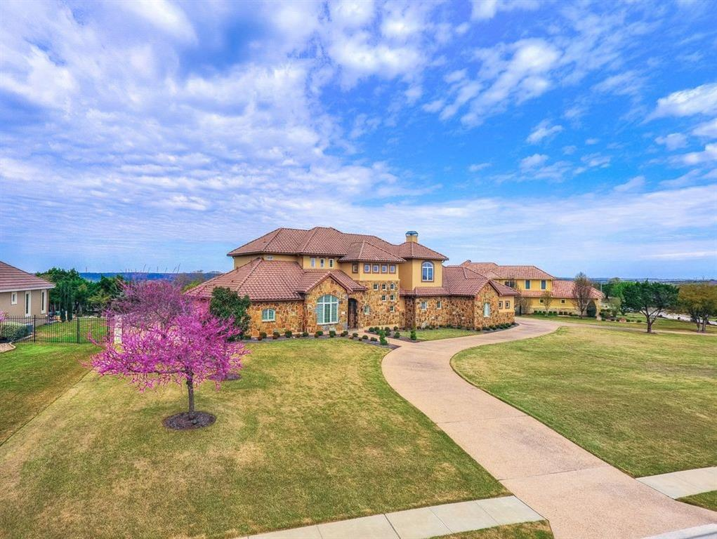 Elegant custom home showcasing breathtaking panoramic views on over an acre lot in Grandview Hills. This home takes full advantage of the indoor/outdoor lifestyle w/ a resort style backyard oasis featuring stunning grotto pool and spa w waterfall, multiple outdoor living areas & views for miles. Perfect for entertaining is the open floor plan w open chef's kitchen/family rm w fireplace, large 1st flr master +flex rm, private study, 3 secondary beds + game rm/media up.